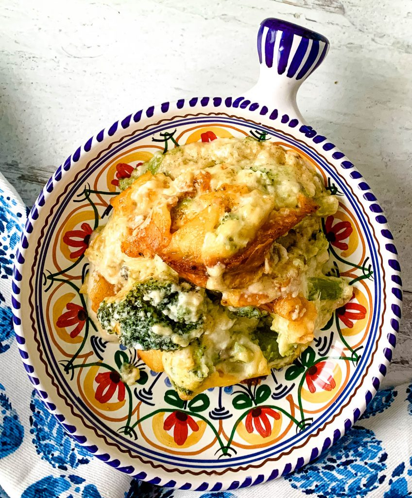 Pinterest Pin image for cheesy cheddar broccoli casserole