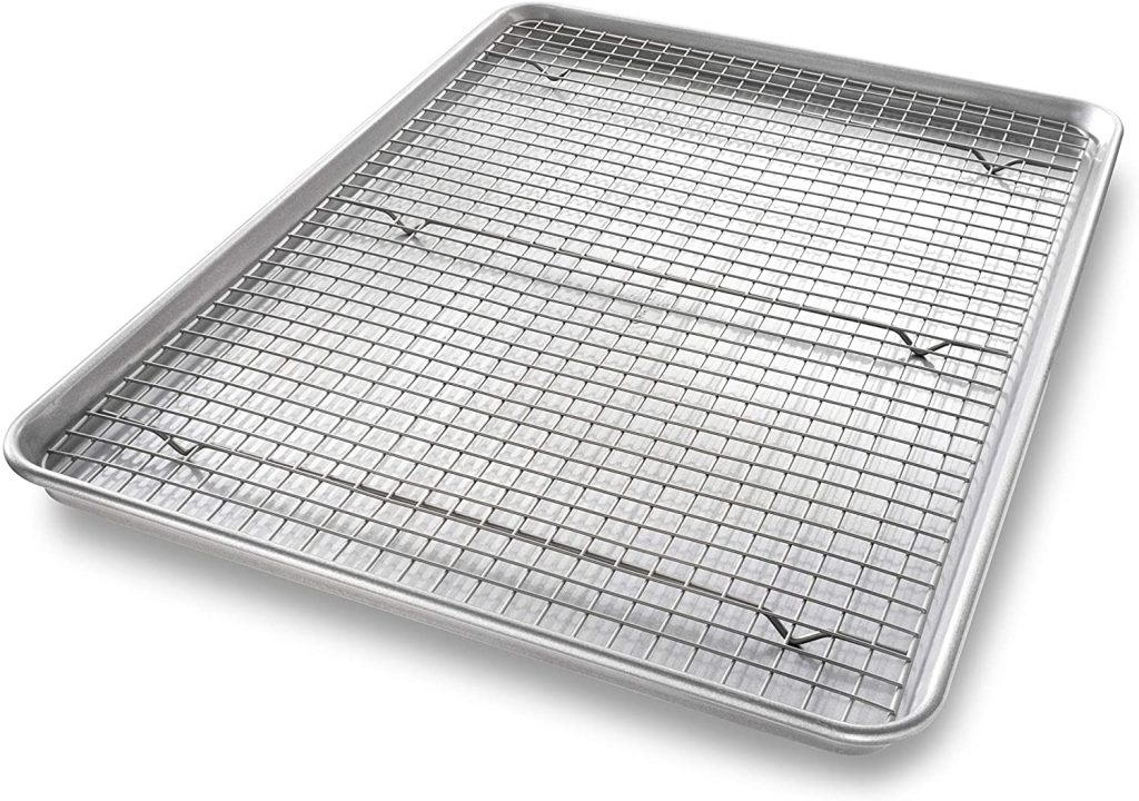 A close up of a baking sheet with a cooling rack