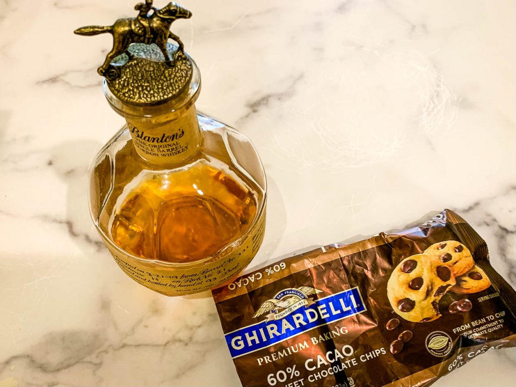 a bottle of Blanton's Bourbon and a bag of Ghirardelli chocolate