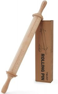 wooden rolling pin with handles and with guides for evenly rolling correct thickness dough