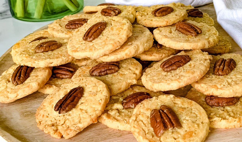 Southern Pecan Cheddar Wafers on a wooden tray