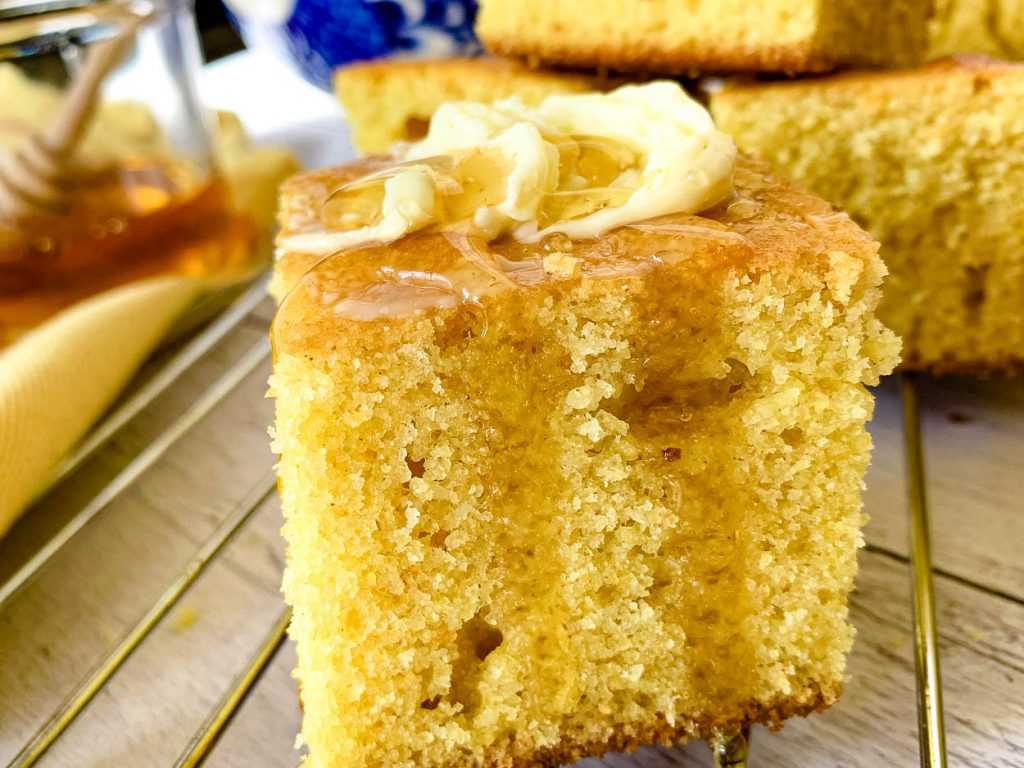 up close picture of Sweet Buttermilk Cornbread with butter and honey
