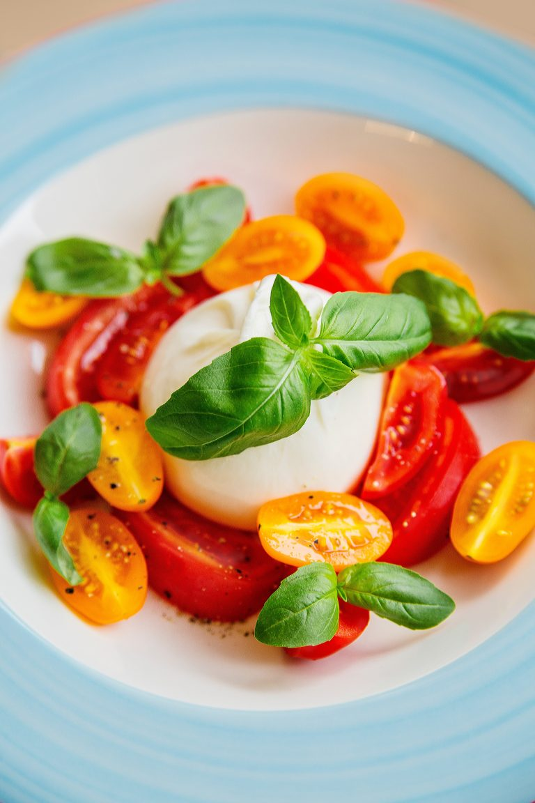 bowl of tomatoes and basil