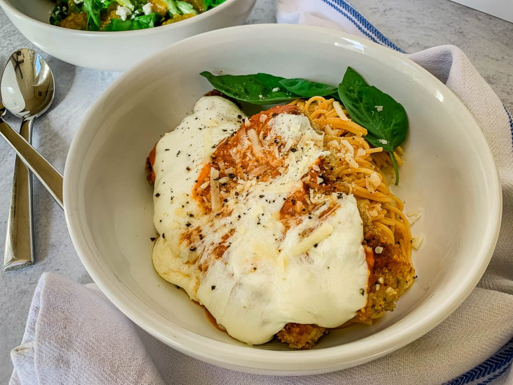 Favorite Quick 'n' Easy Crispy Pork Cutlets Parmigiana in a white bowl
