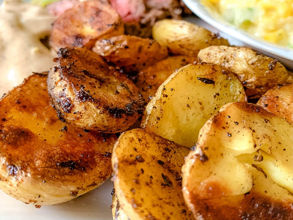 patatas bravas or fried potatoes on a dish with steak and corn