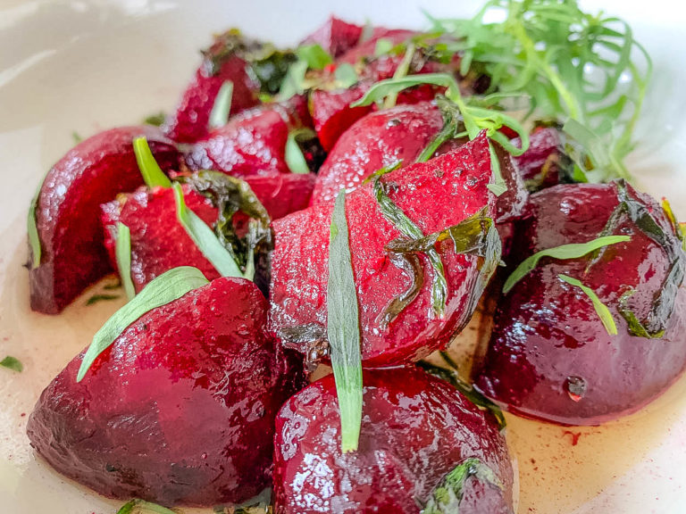close up of sautéed beets in brown butter with tarragon