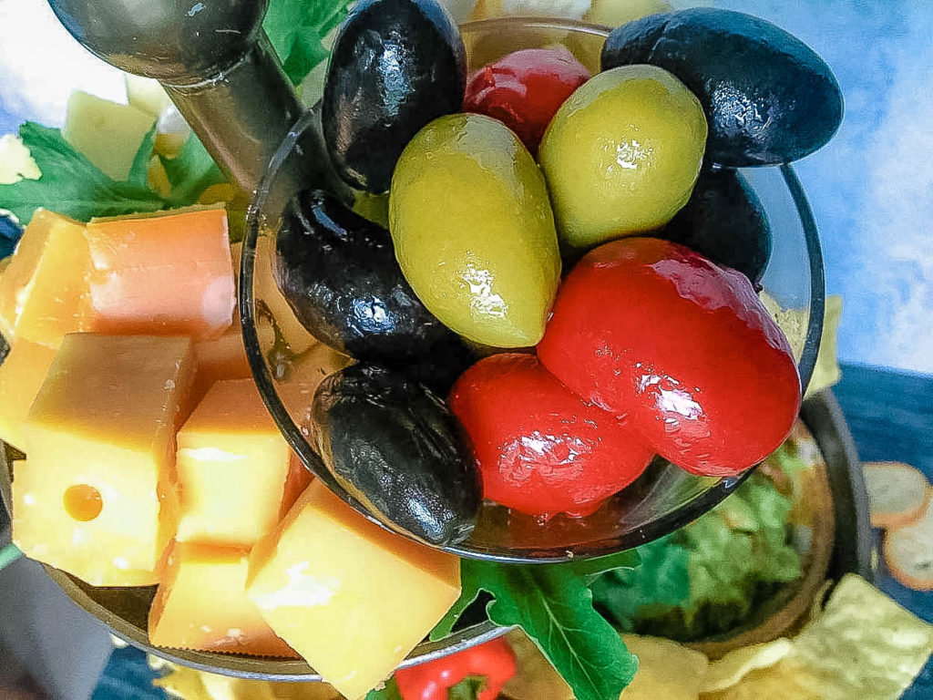 close up of hot sweet peppers and olives, with cheese
