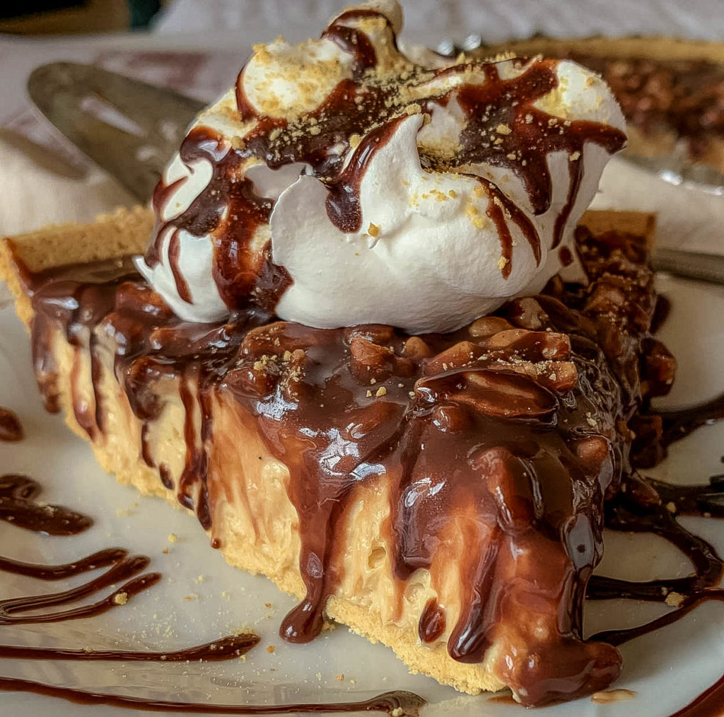 slice of pie on a white plate, with peanut butter and chocolate