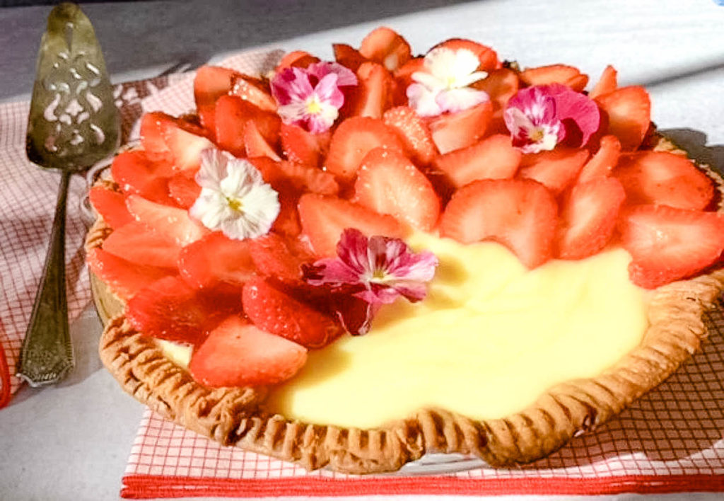 overhead photo of A Sweet Sunshine By The Slice Strawberry And Lemon Pie