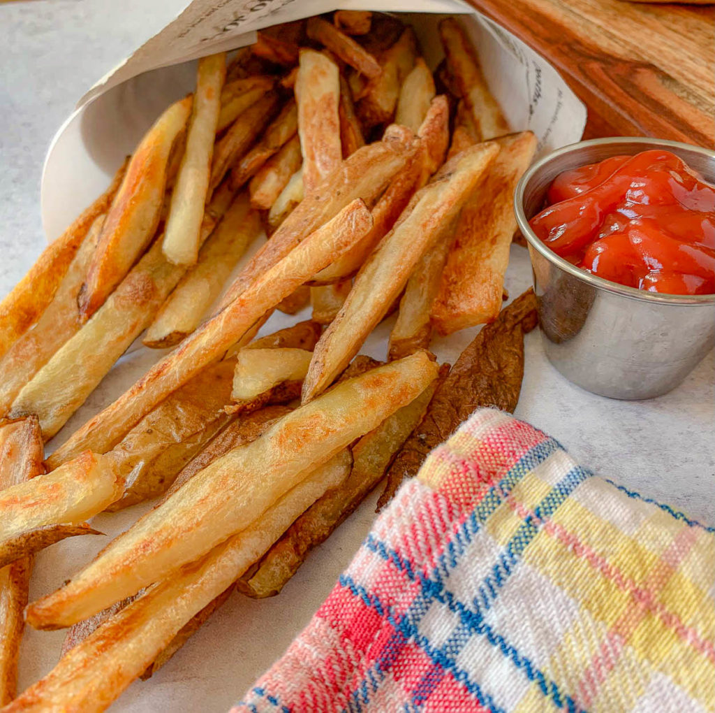 close up photo of Crispy Oven Fries, with Ketchup