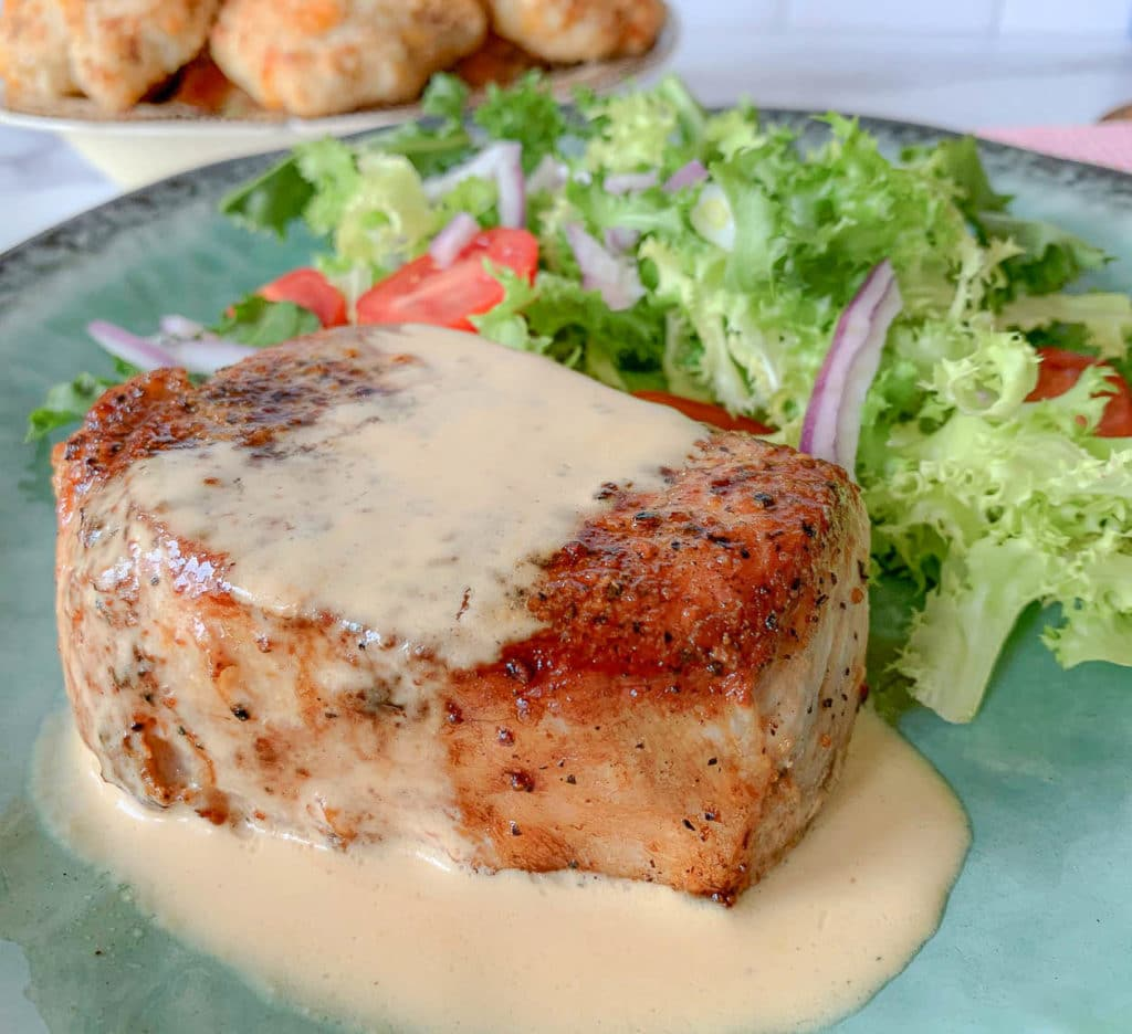 pork chop with sauce, with green plate