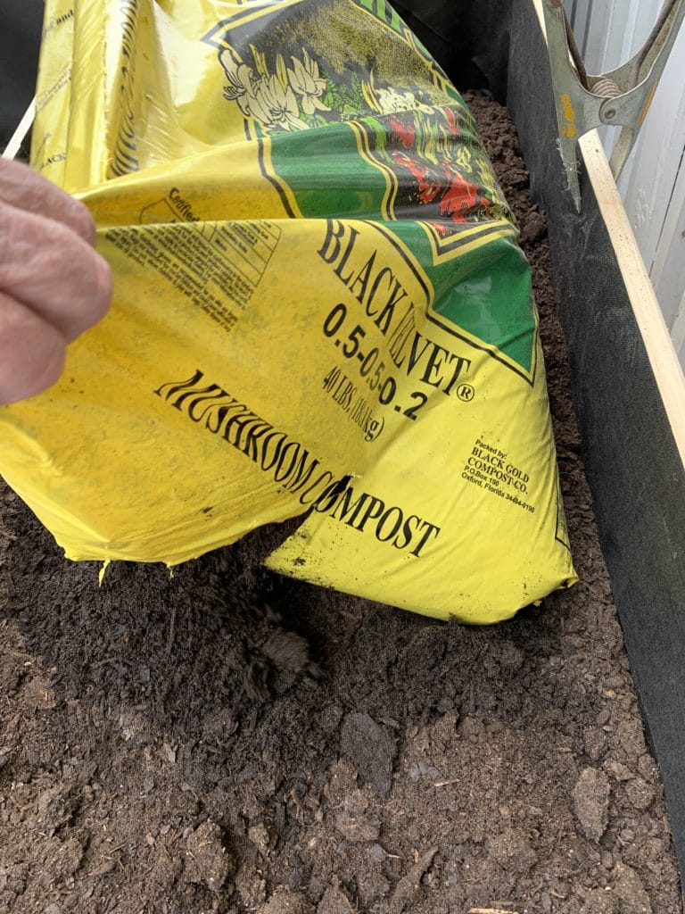 a trough of dirt, with yellow bag