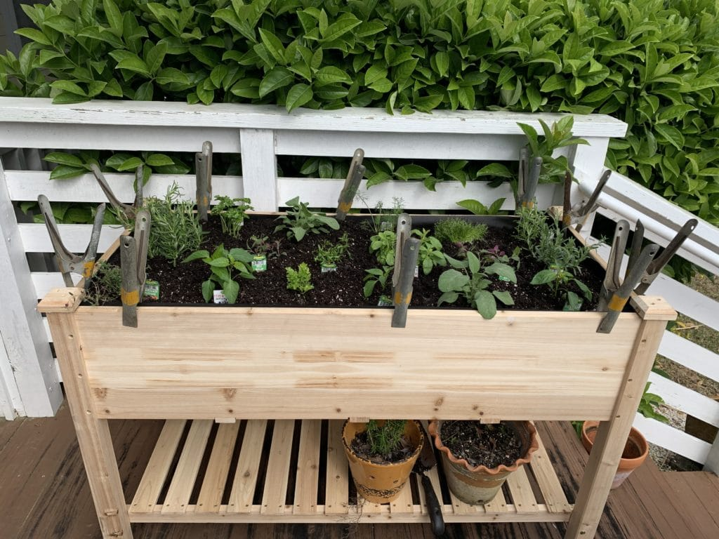 a large wooden planter, with plants