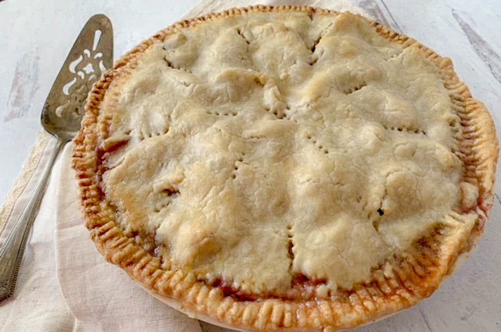 a pie on a counter, with pie server