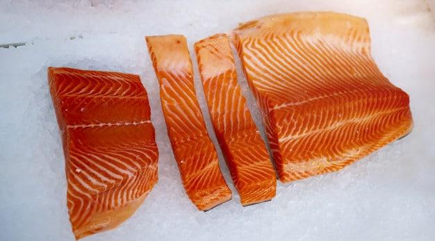 salmon filets on ice