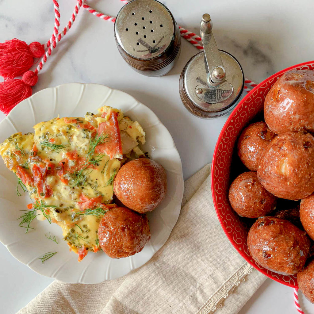 Smoked Salmon Brunch Frittata on a white plate, with hushpuppies