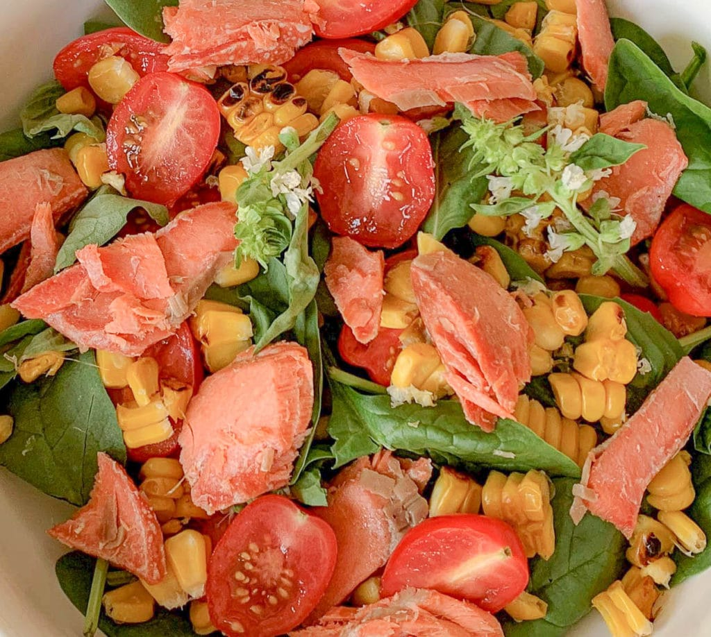 close up of a salad, with salmon