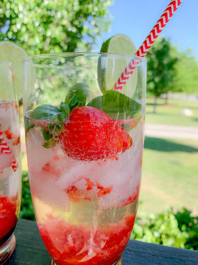 close up of a glass with strawberries, with gin