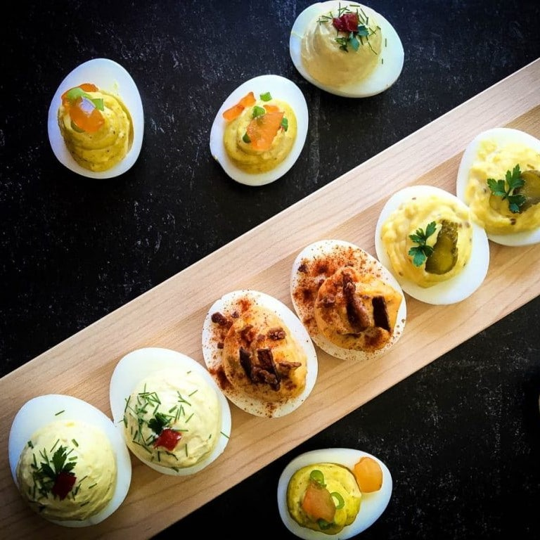 deviled eggs on a wooden board