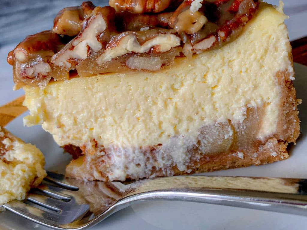 close up of a slice of Apple Bottom Bourbon Pecan Cheesecake