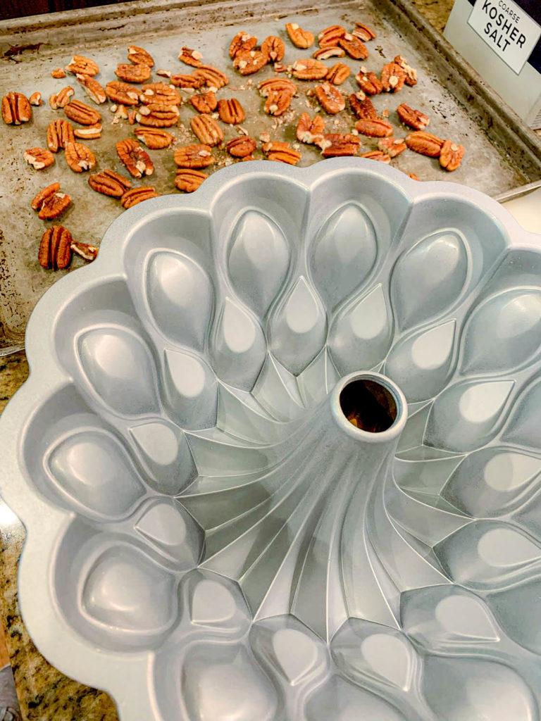 inside of a bundt pan, with pecans
