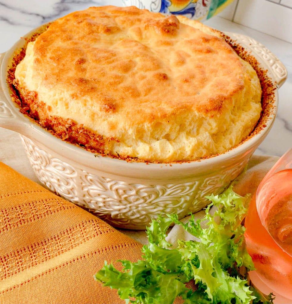 a soufflé dish with an Egg Soufflé Recipe With Autumn Herbs