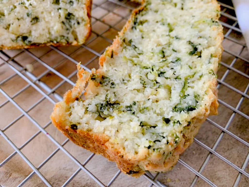 a slice of Spinach Feta Cheese Bread cooling on a rack