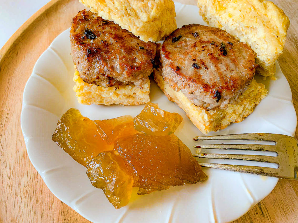 sausage on a biscuit with watermelon rind preserves