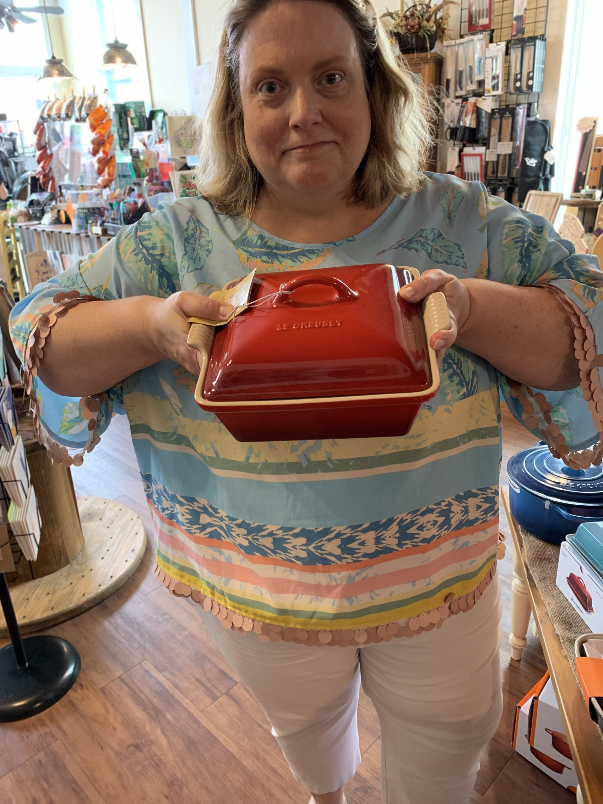 woman holding a covered casserole dish