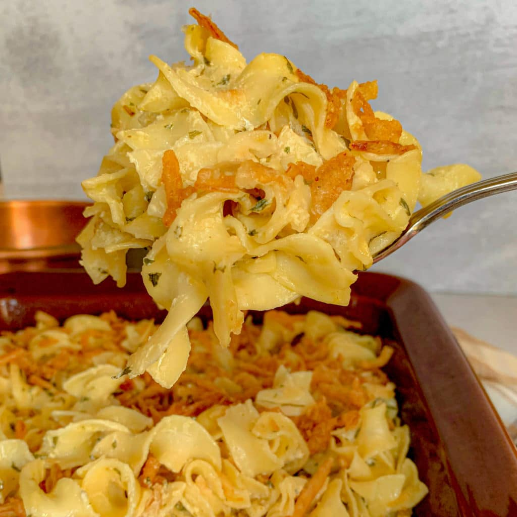 noodles in a casserole dish with french fried onions